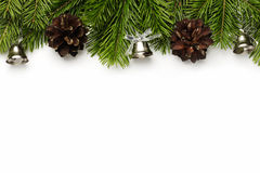 Christmas tree branches. Christmas/New Year's tree branches with silver bells and cones isolated on white Royalty Free Stock Photography