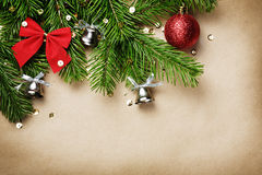 Christmas tree branches. With new year toys and silver bells on brown paper background Royalty Free Stock Photography