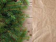 Christmas tree branches and old paper Royalty Free Stock Photography