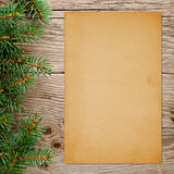 Christmas tree branches and old paper Stock Image