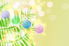 Christmas Tree Branches and Ornaments. On pale cream background Stock Images