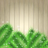 Christmas tree branches over light desk Royalty Free Stock Photo