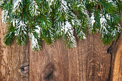 Christmas tree branches over wooden background. Green border Royalty Free Stock Photos