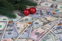 Christmas tree branches red balls on money background. Christmas tree branches red balls on money background Stock Photography