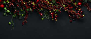 Christmas tree branches and red berries royalty free stock photography