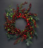 Christmas tree branches and red berries. Background Royalty Free Stock Photography