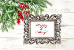 Christmas tree branches red berries. Picture frame Happy Merry Stock Photo