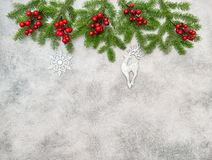 Christmas tree branches red berries silver ornaments decoration Stock Photo