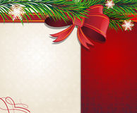 Christmas tree branches with red bow Stock Photography