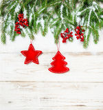 Christmas tree branches with red decoration. Winter holidays Stock Photo