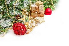 Christmas tree branches red golden ornaments gift box snow Stock Images