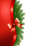 Christmas tree branches with a red ribbon and a bow. Vector Stock Image