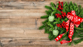 Christmas tree branches red ribbon on wooden background Royalty Free Stock Images