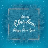 Christmas tree branches with slogan and silver thin frame and snow on blue background. Lettering Happy New year. Background perfect for inventation, winter Stock Images