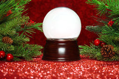 Christmas tree branches with snowglobe Stock Photography
