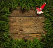 Christmas tree branches with snowman on wooden texture Stock Photos
