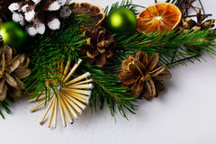 Christmas tree branches with straw stars and pine cones stock photos