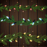 Christmas tree branches. Vector illustration of christmas garlands with green, red, blue and yellow stars on a dark wooden background. Beautiful decorative Royalty Free Stock Photo