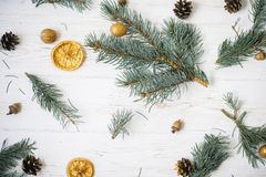 Christmas tree branches on a white wooden background. Christmas flatlay stock photo