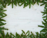 Christmas tree branches on white wooden texture ready for your d Stock Photo