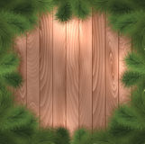 Christmas tree branches on wood. Christmas tree branches on a wooden background Royalty Free Stock Photos