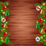 Christmas tree branches on wood background Royalty Free Stock Images
