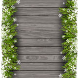 Christmas tree branches on wood background. Christmas tree branches on a wooden background Royalty Free Stock Photo