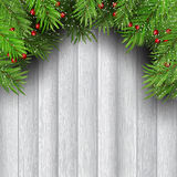 Christmas tree branches on wooden background. Christmas tree branches with berries on wooden background Stock Images