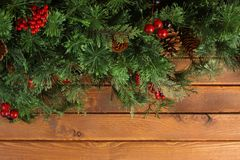Christmas tree branches on wood. En background Royalty Free Stock Photography