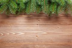 Christmas tree branches on wooden background. Royalty Free Stock Photo