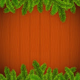 Christmas tree branches on wooden background. Vector Christmas tree branches on wooden background Royalty Free Stock Photo