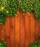 Christmas tree branches on wooden background. Vector illustration. Holiday backdrop. Place for your text message. Green spruce branches Royalty Free Stock Photo