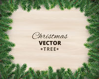 Christmas tree branches on wooden background, vector illustration. Realistic fir-tree border, frame. Great for christmas cards, banners, flyers, party posters Royalty Free Stock Photos