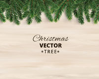 Christmas tree branches on wooden background, vector illustration. Realistic fir-tree border, frame. Great for christmas cards, banners, flyers, party posters Stock Photo