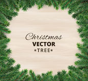 Christmas tree branches on wooden background, vector illustration. Realistic fir-tree border, frame. Great for christmas cards, banners, flyers, party posters Stock Photography
