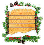 Christmas tree branches and wooden billboard Stock Photography