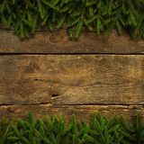Christmas tree branches on wooden texture Stock Images