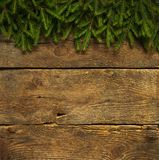 Christmas tree branches on wooden texture Royalty Free Stock Photos
