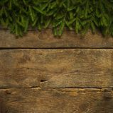 Christmas tree branches on wooden texture Stock Photo