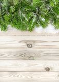 Christmas tree branches wooden texture Winter background. Christmas tree branches on wooden texture. Winter holidays background stock image