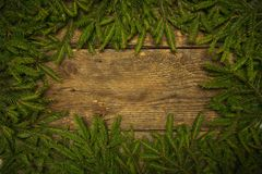 Christmas tree branches on wooden texture Royalty Free Stock Photo