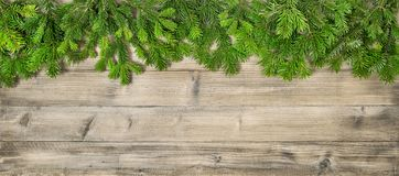 Christmas tree branches wooden texture background. Christmas tree branches on wooden texture. Winter holidays background royalty free stock photo