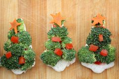 Christmas tree of bread  broccoli and tomatoes Royalty Free Stock Image