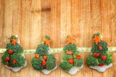 Christmas tree of bread  broccoli and tomatoes Stock Photo