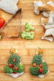 Christmas tree of bread  broccoli and tomatoes Royalty Free Stock Photo