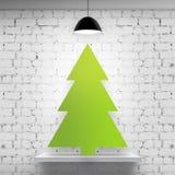 Christmas tree in brick interior Stock Image