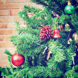 Christmas tree with brick wall, retro effect Stock Photo