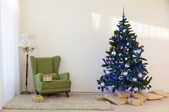 Christmas tree in a bright room new year gifts Stock Image