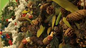 Christmas tree with brown toys and decorations background. Close-up. In the hypermarket. stock video footage