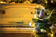 Christmas tree with piano. Christmas tree with bubbles on the background of an old piano Royalty Free Stock Image